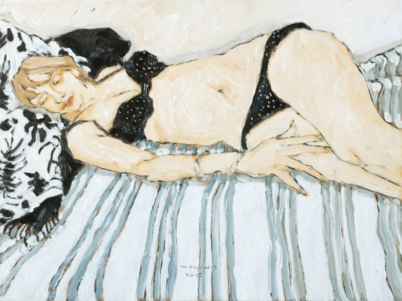 Reclining Model on Striped Blanket Image 1