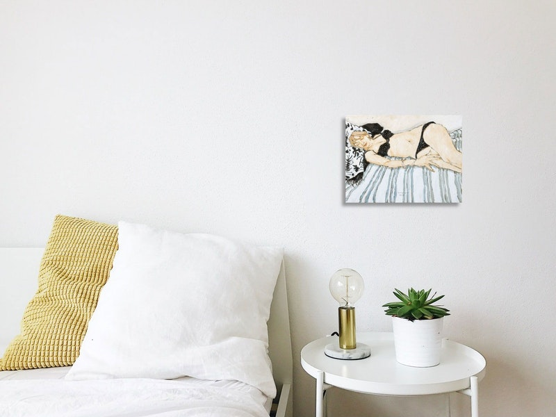 Reclining Model on Striped Blanket Image 3