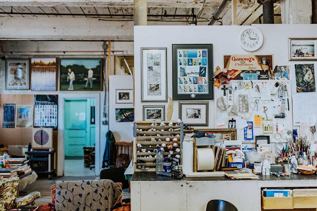 Person, Human, Furniture, Workshop, Table, Shelf, Indoors, Room, Living Room, Interior Design, LCD Screen, Monitor, Screen, Display, Electronics, Flooring